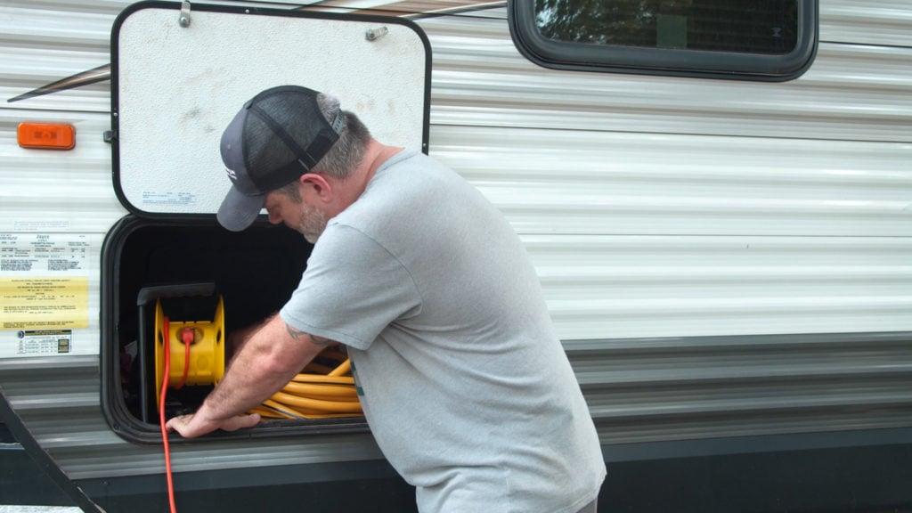Hose and cord storage in an RV