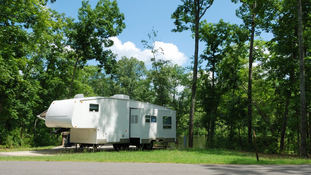 Fifth wheel trailer at campsite