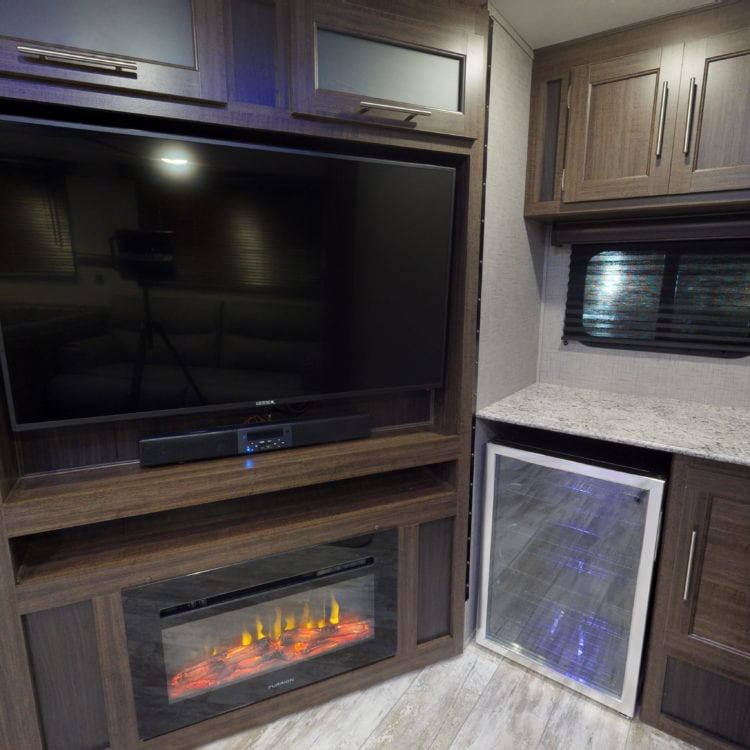 What's Hiding Behind the Fireplace in This Travel Trailer?