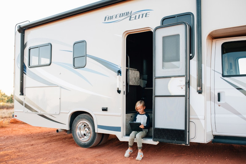 child sitting open rv door