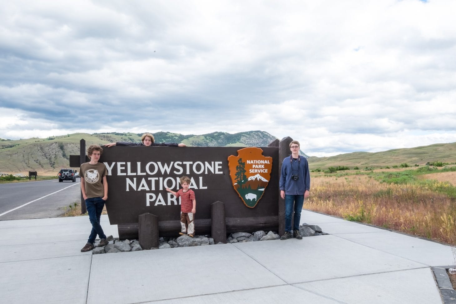 family at Yellowstone national park entrance