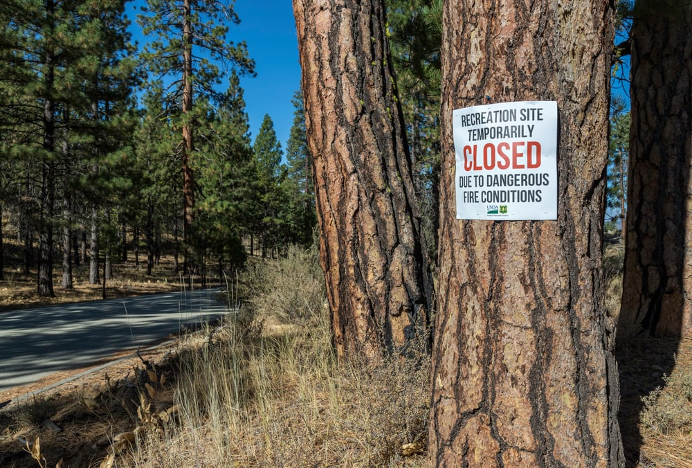 sign showing campground closed due to fires