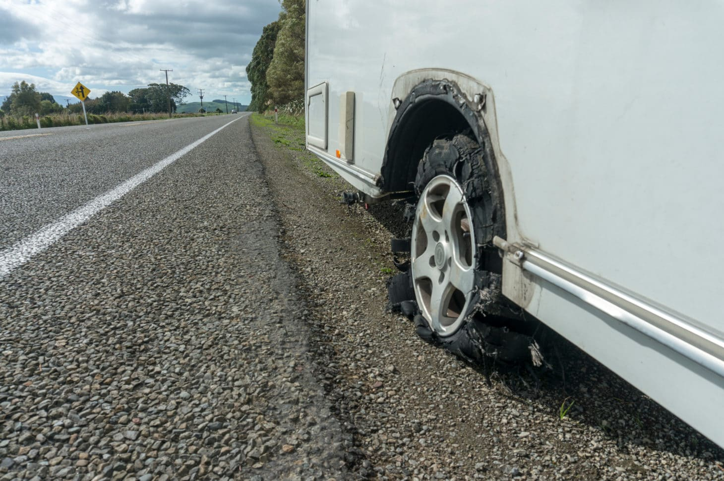 Blown out tire on an RV pulled over on side of the road