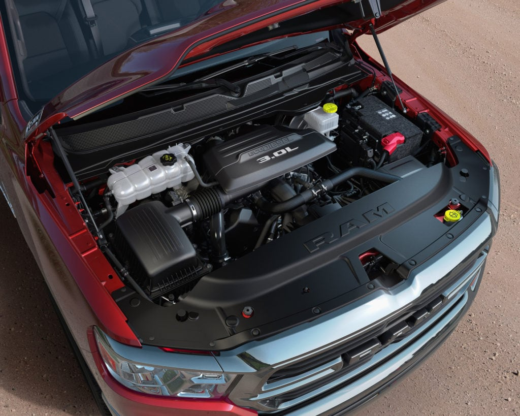 Open hood of a pickup truck with an eco diesel engine