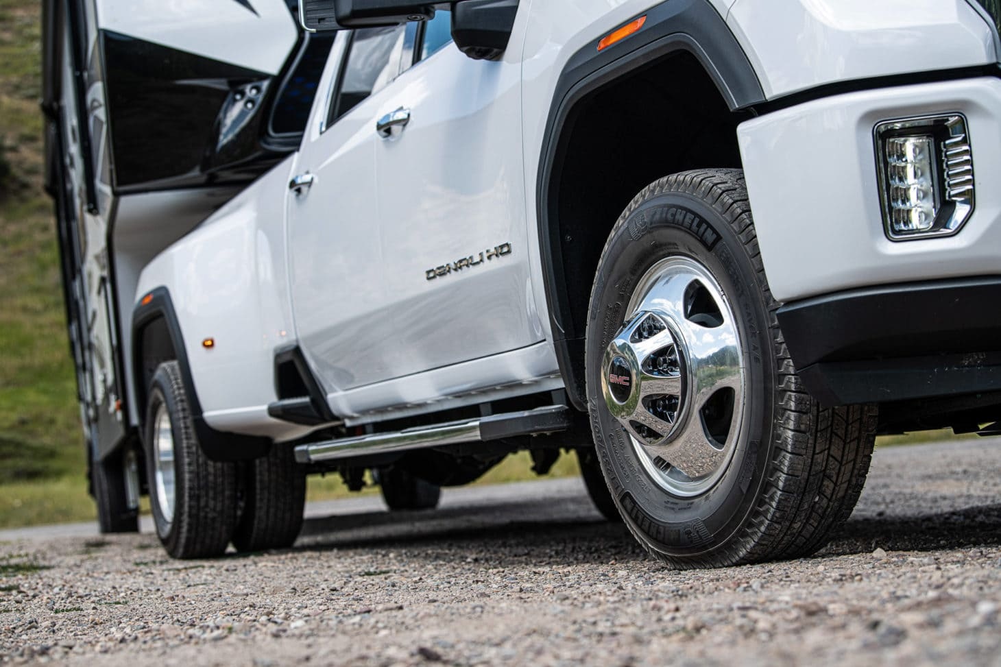 Close up of wheels on a pickup truck towing a travel trailer