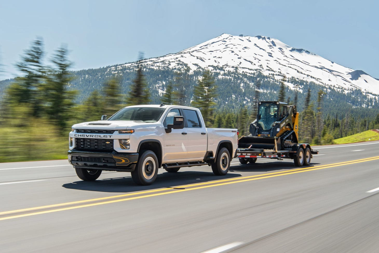 Chevrolet truck towing a construction vehicle