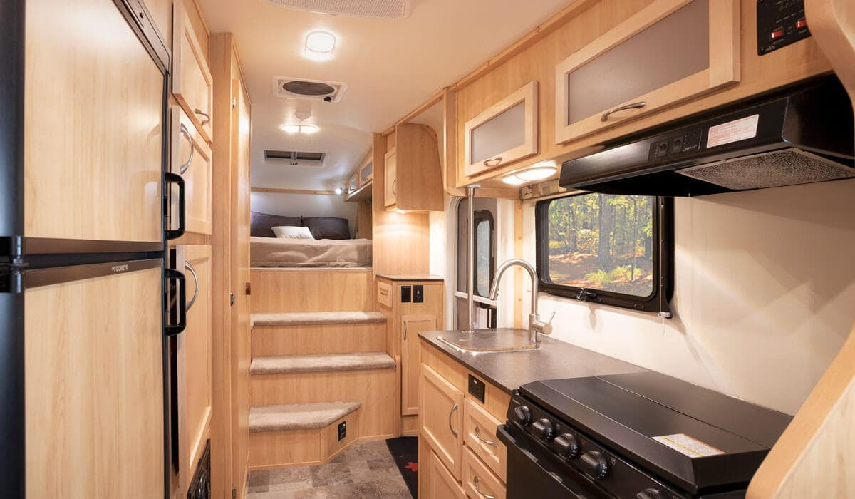 Interior view of fifth wheel trailer kitchen and bedroom area