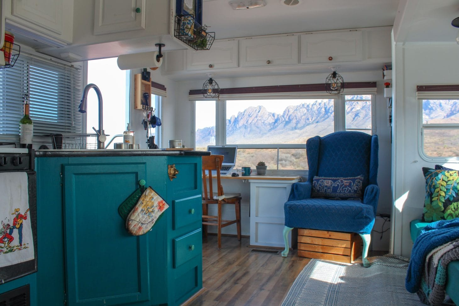 Interior of RV renovated with kitchen and office space