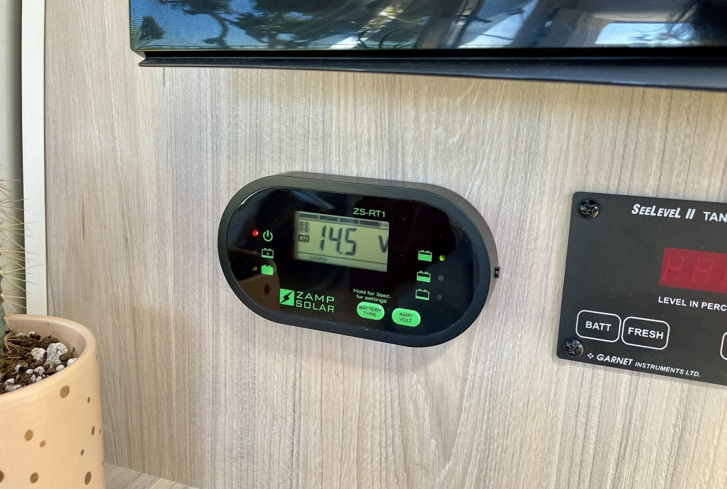 View of RV solar panel battery display screen