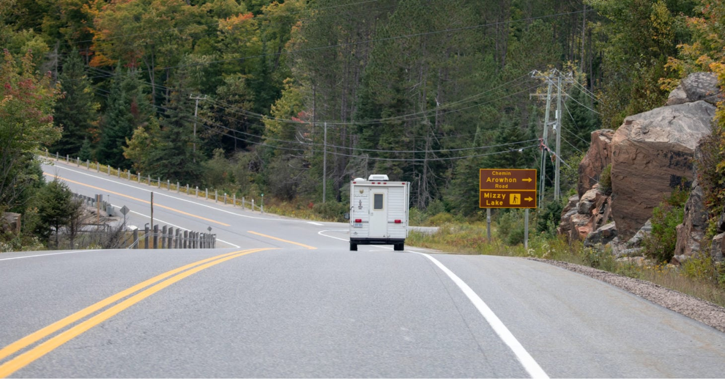 RV driving down road in Ontario near outdoor points of interest