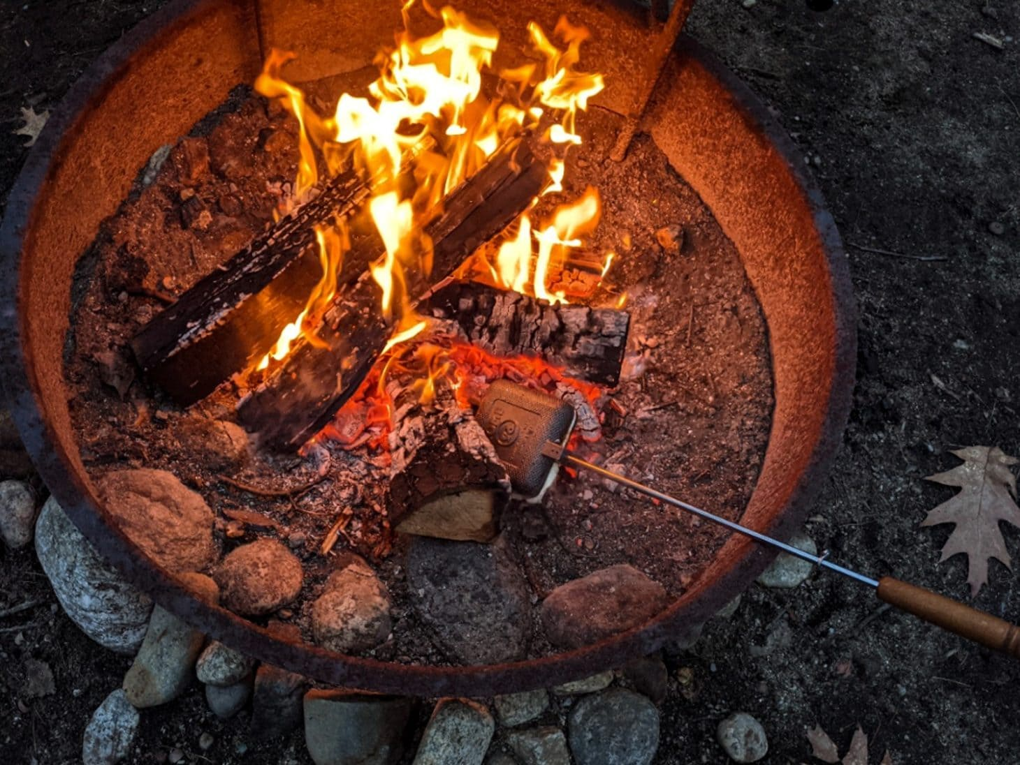 Pie iron cooking directly in campfire