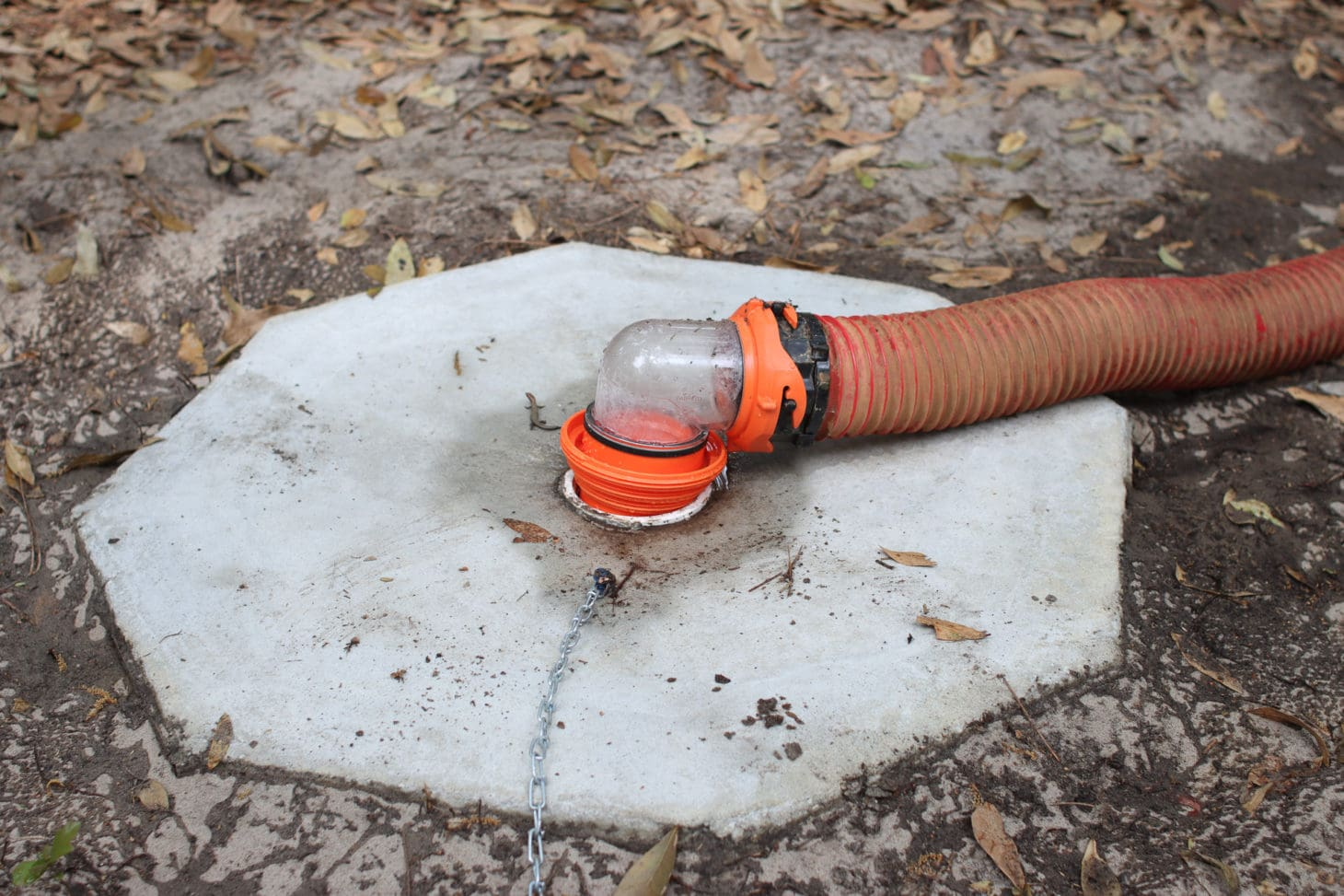 Sewer hose connected to a sewer output at a campsite