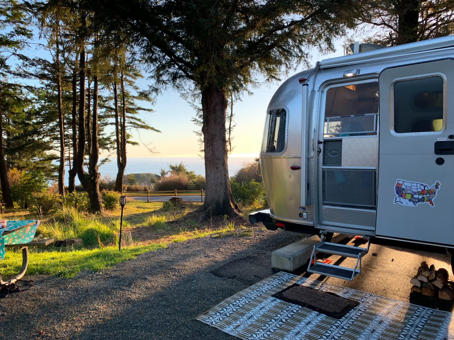 Airstream parked at campsite overlooking Pacific Ocean